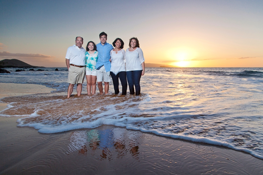 Family poses for a portrait at sunset in Wailea, Hawaii.