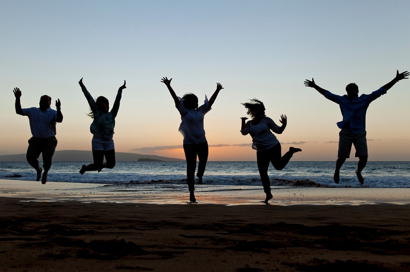 Jumping family silhouetted against Maui's beautiful Wailea sunsets.